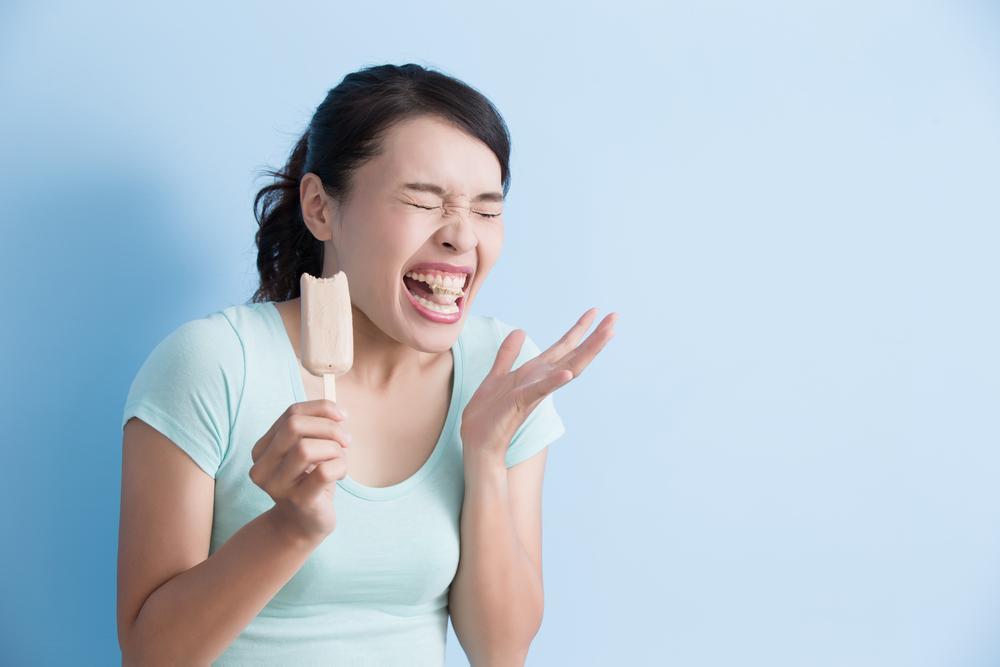 Чувствительность зубов к холодному: причины и лечение